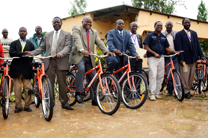 Community leaders test out the new bikes before they are distributed to the CHWs.