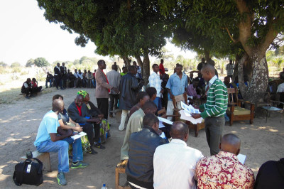 A group of traditional village leaders gathers for an orientation on community-led total sanitation.