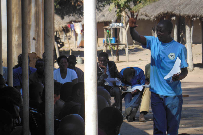 Community Champion Chris Malambo teaches community-led total sanitation.