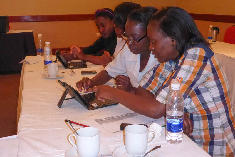 Training participants learn to use Android-based tablets.