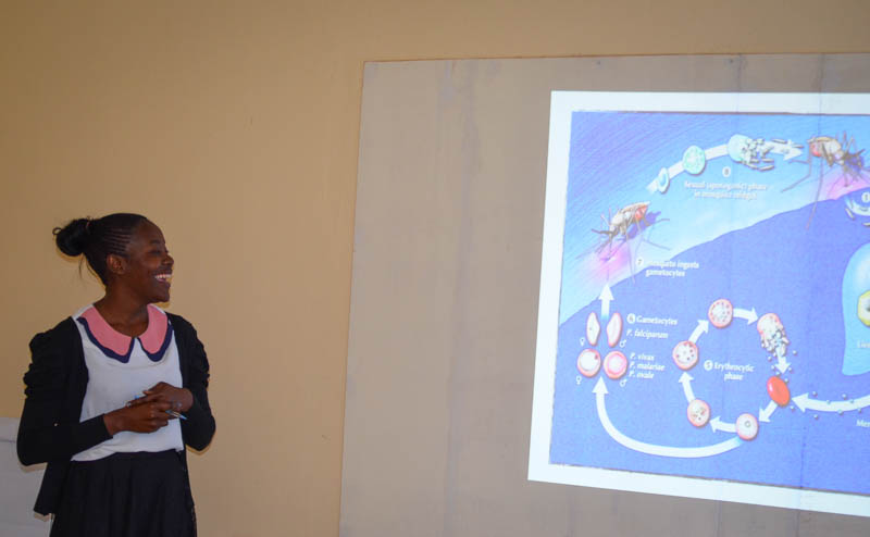 Mulenga Mwenda, the Laboratory Technologist, Akros Laboratory Technologist, gives a presentation on malaria and its cycle.