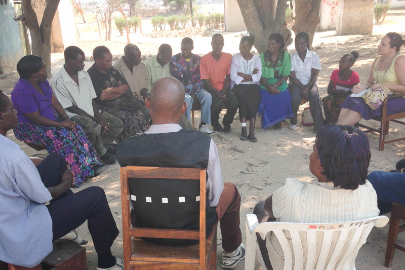 Annie Glover (far right) meets with Community Health Workers in Zambia's Choma District as part of her practicum work with Akros.