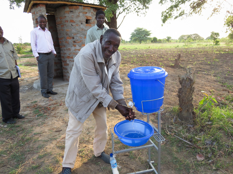 A man uses a hand washing facility, one of the CLTS tools promoted by Chief Mukobela.
