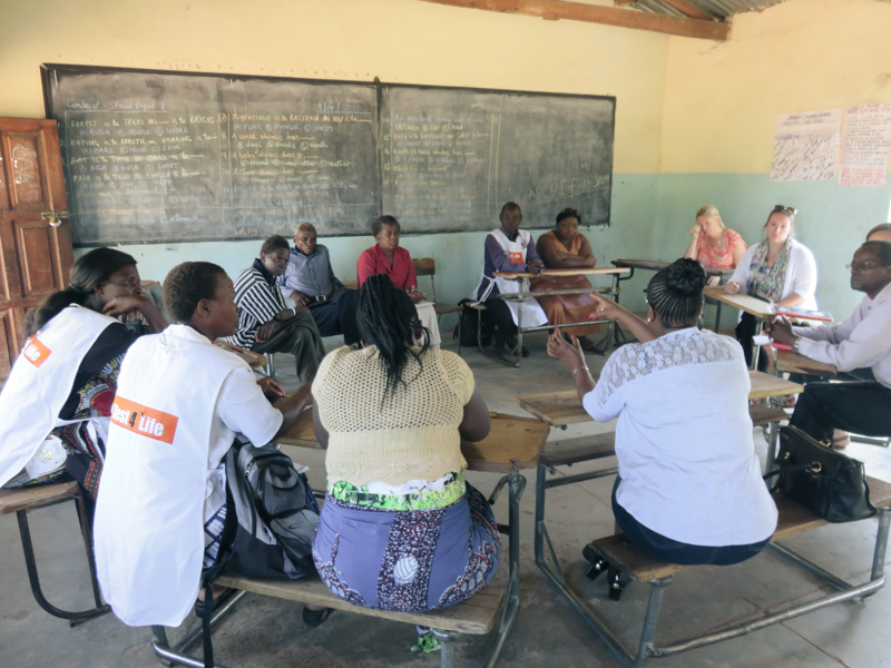 CHWs having focus group discussions with various stakeholders