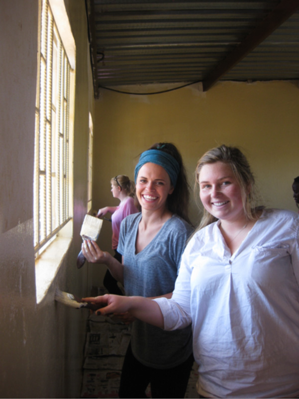 MSU students Lizza Redfern and Tory Evans painting a classroom at Mercy School.