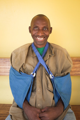Cairo Situlo, a CHW from Zimba, recovering from an automobile accident in September that broke both of his arms.