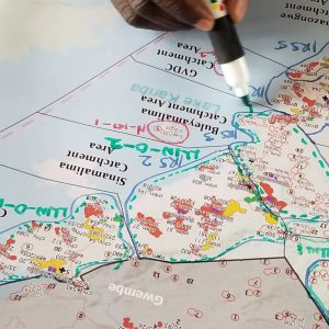 Government Planners use detailed maps to plan IRS and ITN resources in Southern Province, Zambia.
